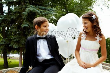 Portrait of children bride and groom with balloons chatting in park Stock Photo - Royalty-Free, Artist: pressmaster                   , Code: 400-04919869