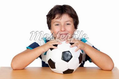 Adorable boy with a soccer ball isolated on white background Stock Photo - Royalty-Free, Artist: Gelpi                         , Code: 400-04922615