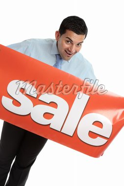 A happy salesman, businessman or other marketing person holding a vinyl sale banner.  White background. Stock Photo - Royalty-Free, Artist: lovleah                       , Code: 400-04926326