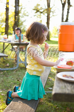 Little Girl Eating at Picnic Stock Photo - Premium Rights-Managed, Artist: Ty Milford, Code: 700-04931693