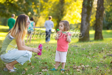 Little Girl and Woman Blowing Bubbles in Park Stock Photo - Premium Rights-Managed, Artist: Ty Milford, Code: 700-04931695