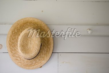 Close Up of A Straw Hat Hung On A Peg Stock Photo - Royalty-Free, Artist: robhillphoto                  , Code: 400-04948368