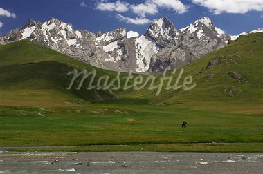 Highmountains massif Sary-Beles (Kirgizstan). Ketmen' peak. ?orseman Stock Photo - Royalty-Free, Artist: Vasca                         , Code: 400-04977293