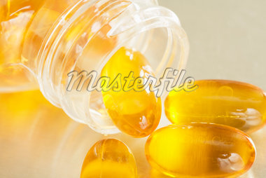 Pills Spilling from Bottle Stock Photo - Premium Royalty-Free, Artist: Amy Whitt, Code: 600-04981827