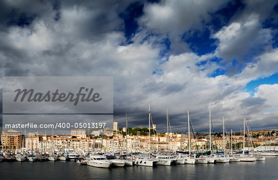 Images shows the Vieux Port (old port) in the city of Cannes, southern France, under a dramatic cloudy sky Stock Photo - Royalty-Free, Artist: akarelias                     , Code: 400-05013197