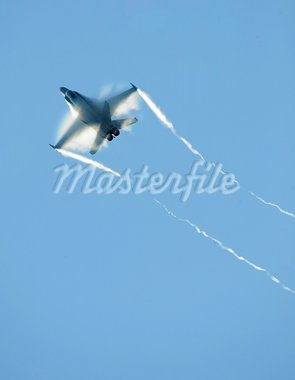 An air force jet fighter streaks through the sky. Stock Photo - Royalty-Free, Artist: sportlibrary                  , Code: 400-05066602
