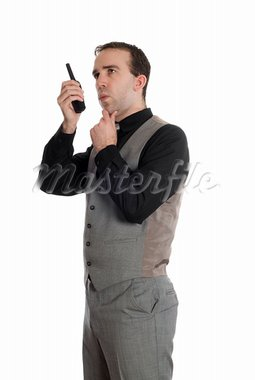 A young businessman wearing a grey suit, talking on a walkie talkie, isolated against a white background Stock Photo - Royalty-Free, Artist: dragon_fang                   , Code: 400-05120883