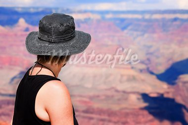 Female hiker looking over the ridge of the Grand Canyon Stock Photo - Royalty-Free, Artist: creatista                     , Code: 400-05178205