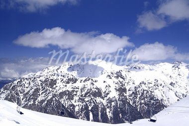 Chair-lift at ski resort. Caucasus Mountains,  Dombay. Stock Photo - Royalty-Free, Artist: BSANI                         , Code: 400-05253750