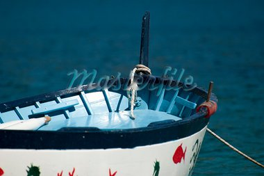 An old colored rowboat anchored in the sea Stock Photo - Royalty-Free, Artist: cla78                         , Code: 400-05254939