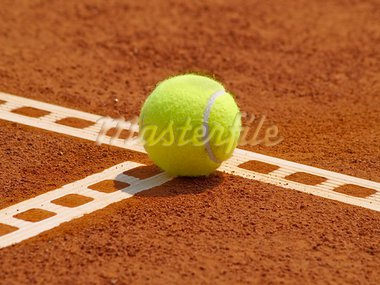 Detail of clay court with tennis ball on the line Stock Photo - Royalty-Free, Artist: maryo990                      , Code: 400-05257834
