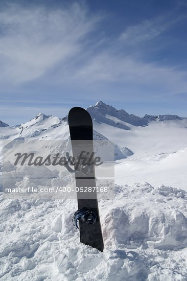 Snowboard against the beautiful mountains Stock Photo - Royalty-Free, Artist: BSANI                         , Code: 400-05287168