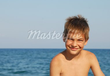 happy teen boy smiling portrait on seaside Stock Photo - Royalty-Free, Artist: simply                        , Code: 400-05297530