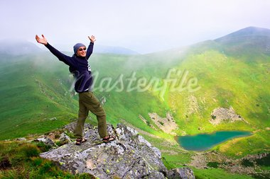 Beautiful mountains landscape with lake  in Carpathian mountains and man on the top Stock Photo - Royalty-Free, Artist: goinyk                        , Code: 400-05312204