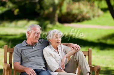 Senior couple sitting on a bench Stock Photo - Royalty-Free, Artist: 4774344sean                   , Code: 400-05314983