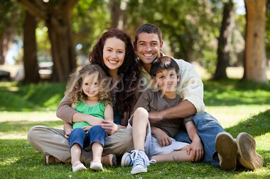 Happy family sitting in the garden Stock Photo - Royalty-Free, Artist: 4774344sean                   , Code: 400-05315202