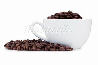 Cup full of coffee beans with coffee beans on the side on a white background Stock Photo - Royalty-Free, Artist: 4774344sean                   , Code: 400-05335153