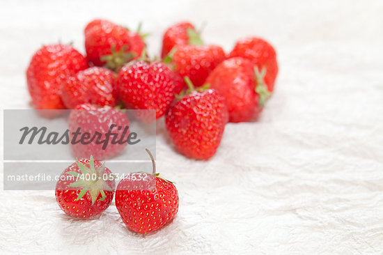 Fresh ripe strawberries on a crinkled white surface Stock Photo - Royalty-Free, Artist: trgowanlock                   , Code: 400-05344632