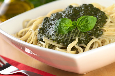Fresh homemade pesto made of basil, garlic and olive oil served on spaghetti and garnished with a basil leaf (Selective Focus, Focus on the basil leaf on the pesto) Stock Photo - Royalty-Free, Artist: ildi                          , Code: 400-05345505