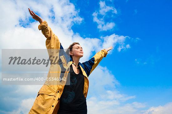 Beautiful young woman under blue sky. Portrait Stock Photo - Royalty-Free, Artist: goinyk                        , Code: 400-05346942
