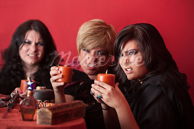 Witch coven with candles over red background Stock Photo - Royalty-Free, Artist: creatista                     , Code: 400-05347613