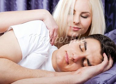 Young beautiful woman gently waking up sleeping man Stock Photo - Royalty-Free, Artist: VILevi                        , Code: 400-05352216