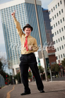 Happy Caucasian businessman points index finger upward Stock Photo - Royalty-Free, Artist: creatista                     , Code: 400-05353762