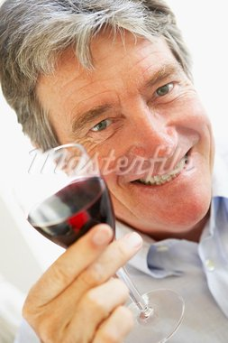 Man Drinking A Glass Of Red Wine Stock Photo - Royalty-Free, Artist: MonkeyBusinessImages          , Code: 400-05354770