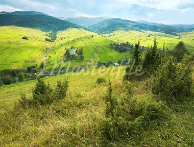 beautiful summer mountain and small village on mountainside (Carpathian. Ukraine) Stock Photo - Royalty-Free, Artist: Yuriy                         , Code: 400-05355975