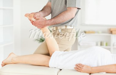 A masseur is massaging a woman's foot in his surgery Stock Photo - Royalty-Free, Artist: 4774344sean                   , Code: 400-05357449