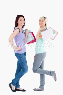 Joyful women with shopping bags in a studio Stock Photo - Royalty-Free, Artist: 4774344sean                   , Code: 400-05357770
