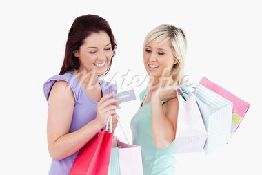 Cheerful women with shopping bags and a card in a studio Stock Photo - Royalty-Free, Artist: 4774344sean                   , Code: 400-05357803