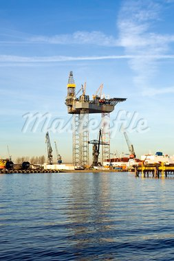 An oil rig is being constructed in a harbor area, to be towed to sea after completion. Stock Photo - Royalty-Free, Artist: corepics                      , Code: 400-05358051