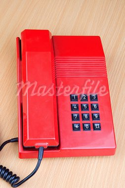 Red classic telephone on a wooden surface Stock Photo - Royalty-Free, Artist: Gelpi                         , Code: 400-05360023