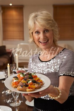 Woman With Hors D'oeuvres For A Dinner Party Stock Photo - Royalty-Free, Artist: MonkeyBusinessImages          , Code: 400-05364196