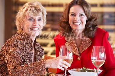 Friends Having Dinner Together At A Restaurant Stock Photo - Royalty-Free, Artist: MonkeyBusinessImages          , Code: 400-05364268