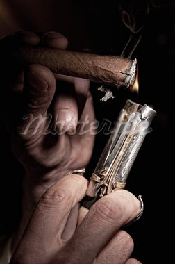 cigarette lighter on a background of fire, black background Stock Photo - Royalty-Free, Artist: artfotoss                     , Code: 400-05370811