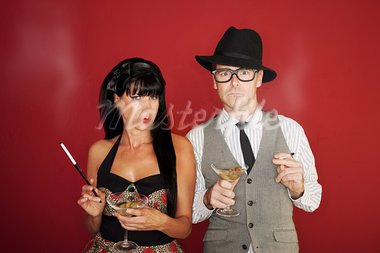 Suspicious Caucasian couple hold martini and cigarette Stock Photo - Royalty-Free, Artist: creatista                     , Code: 400-05372613
