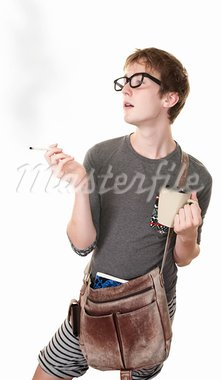 Teen with messenger bag and mug smokes a cigarette Stock Photo - Royalty-Free, Artist: creatista                     , Code: 400-05372649