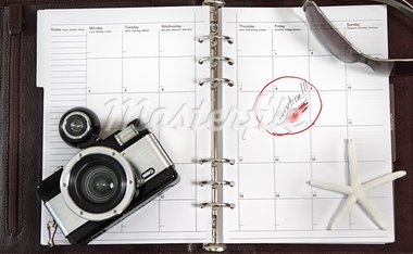 Notebook of the business person waiting for vacation Stock Photo - Royalty-Free, Artist: DashaPetrenko                 , Code: 400-05373069