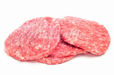 a pile of raw burgers on a white background Stock Photo - Royalty-Free, Artist: nito                          , Code: 400-05373376