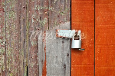 Locked wooden barn door with detailed texture and colour contrast Stock Photo - Royalty-Free, Artist: trgowanlock                   , Code: 400-05373587