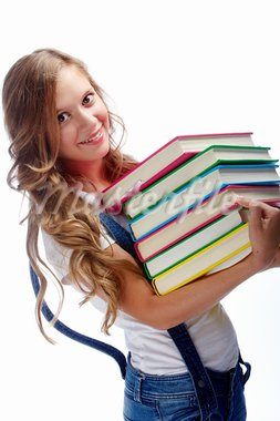 Cute girl with several books smiling at camera in isolation Stock Photo - Royalty-Free, Artist: pressmaster                   , Code: 400-05374919
