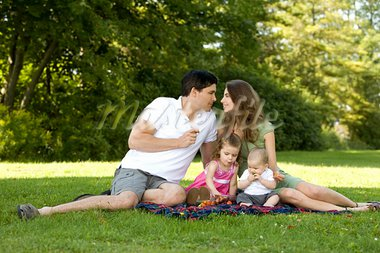 family of four in the park having fun together Stock Photo - Royalty-Free, Artist: zdenkadarula                  , Code: 400-05376069