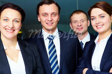 Group of confident business partners looking at camera Stock Photo - Royalty-Free, Artist: pressmaster                   , Code: 400-05377674