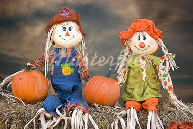 Scarecrow couple sitting on hay bales with pumpkins. Stock Photo - Royalty-Free, Artist: 14ktgold                      , Code: 400-05380861
