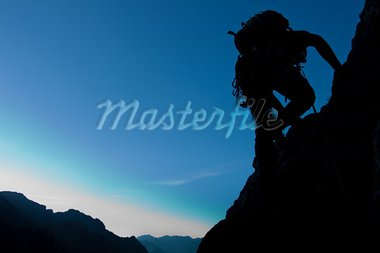Silhouette of a climber with large copay space Stock Photo - Royalty-Free, Artist: jakubcejpek                   , Code: 400-05382140