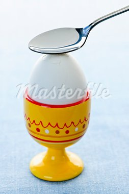 Breaking open a soft boiled egg in cup with spoon Stock Photo - Royalty-Free, Artist: Elenathewise                  , Code: 400-05383364