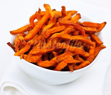 Closeup of sweet potato or yam fries in white bowl Stock Photo - Royalty-Free, Artist: Elenathewise                  , Code: 400-05383367