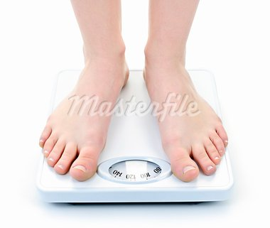 Bare female feet standing on bathroom scale Stock Photo - Royalty-Free, Artist: Elenathewise                  , Code: 400-05383425